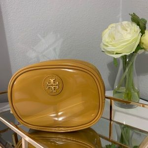 Tory Burch small cosmetic bag, mustard color.